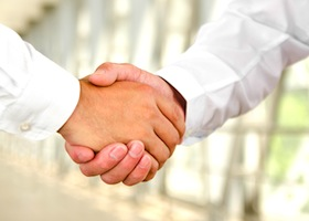 Male handshake isolated on a business background