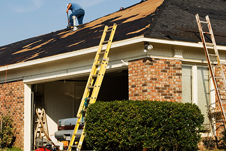 Roofing Experts Repairing a Roof