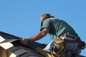 Contractor Installing Roofing Shingles